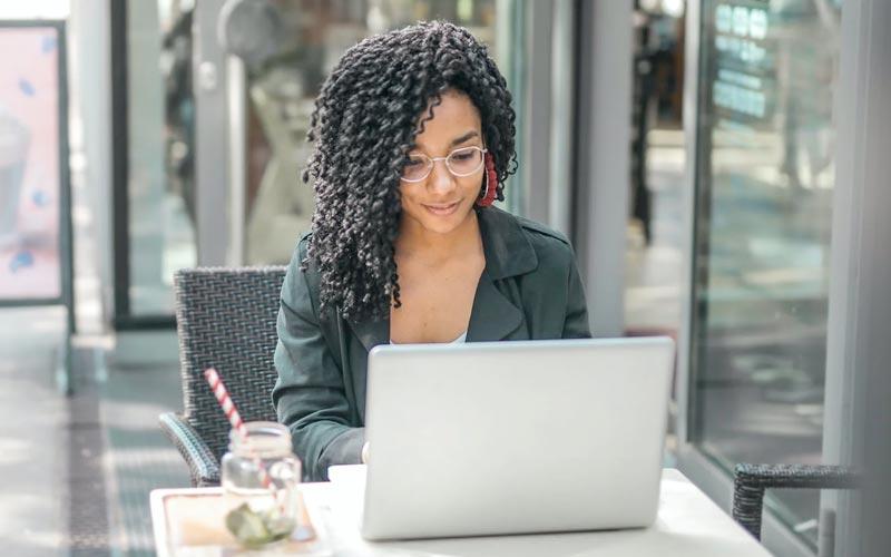 A woman studies on a laptop