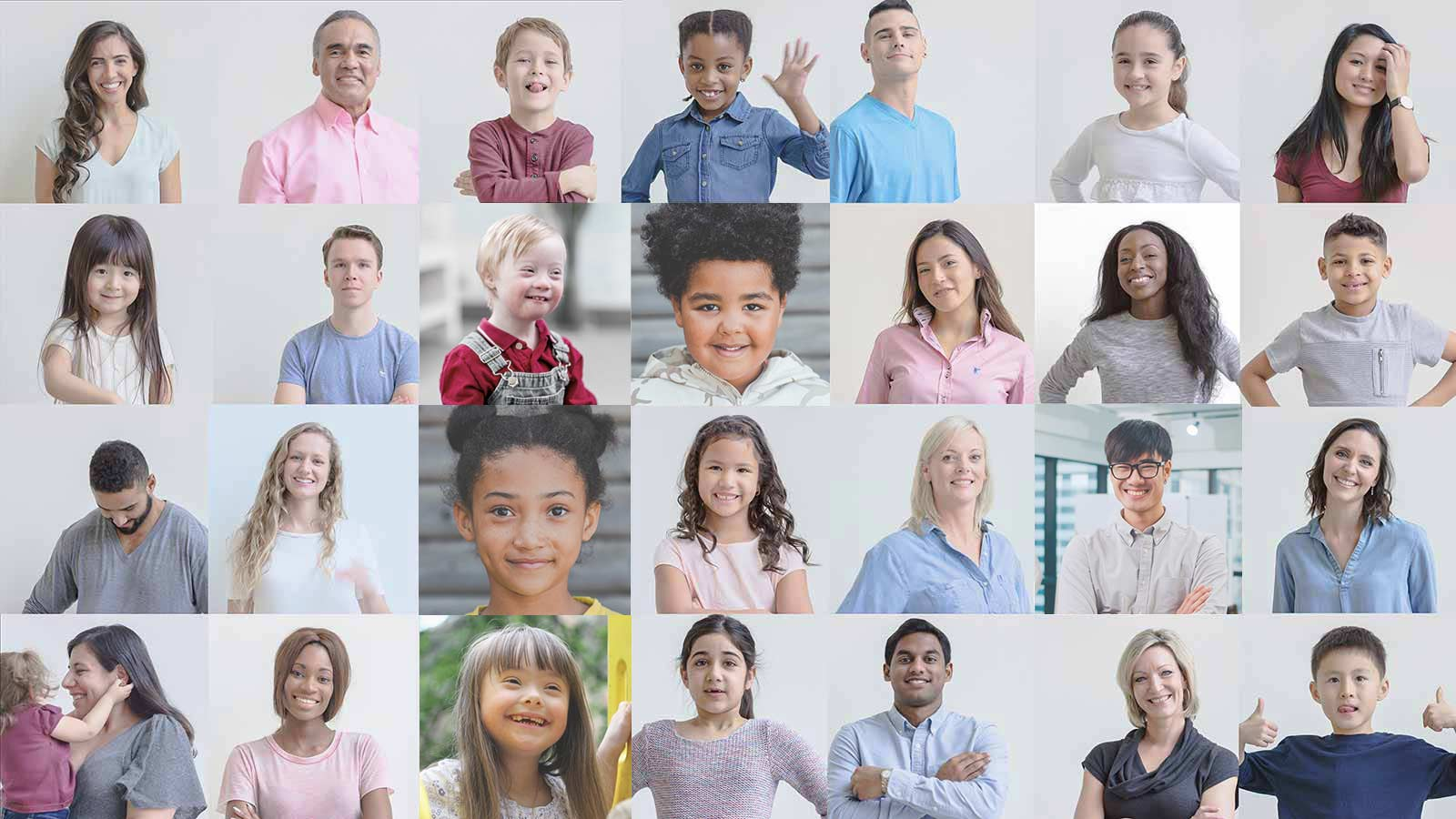 A grid of many young children smiling and happy